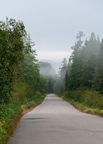 The road disappears into the distance on this misty morning