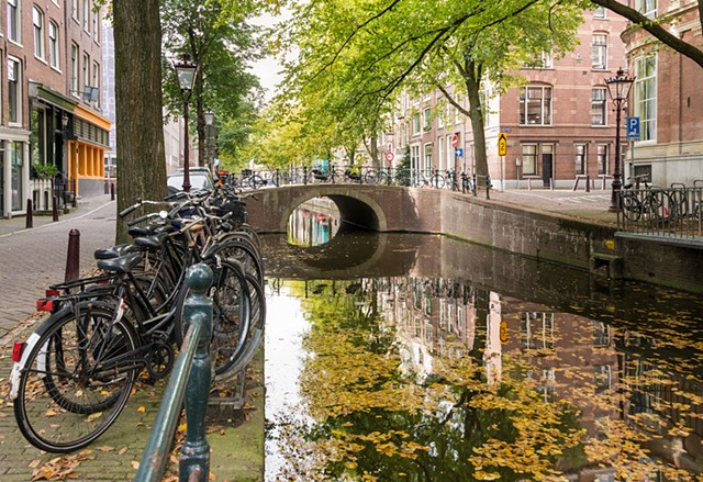 A common sight in Amsterdam, bikes parked by the canal