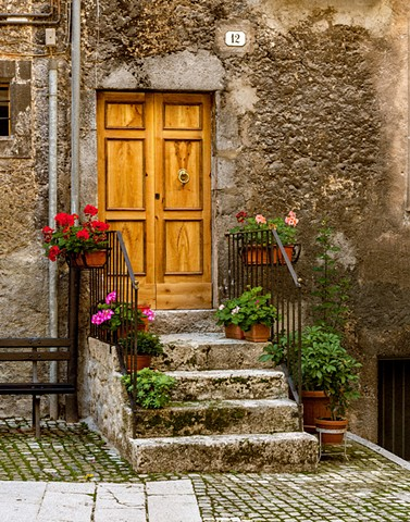 Geraniums and a golden door, up in the mountains in Scanno Italy