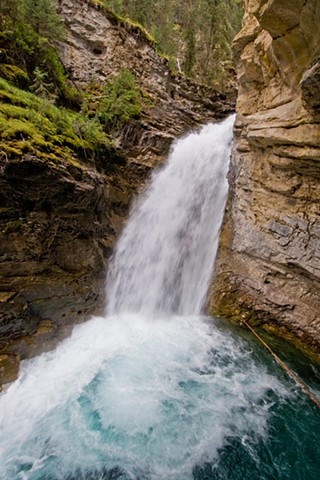 Johnson Falls, turquoise glacial waterfalls cascading down the river, Banff Alberta