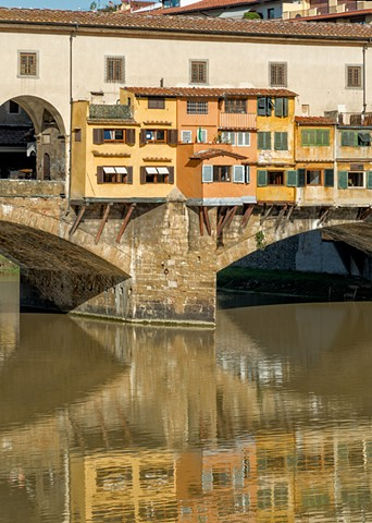 Reflections of the Ponte Vecchio bridge in Florence