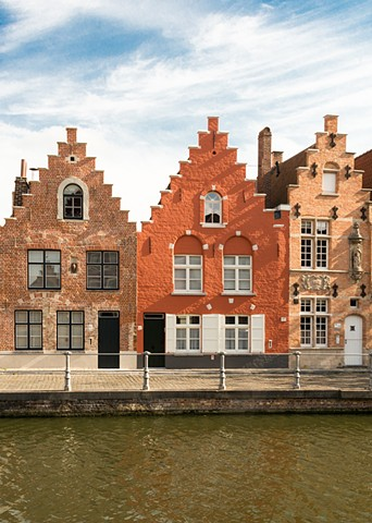 Colourful houses along the canals of Bruges in Belgium