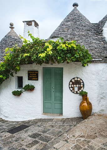 A Trullo in Alberobello, Puglia Italy, White stone houses and conical rock roofs