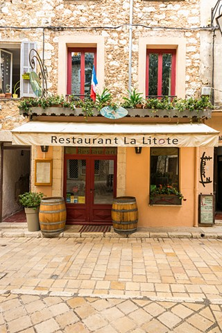 Quiet restaurant in the plaza in the old mountain town of Vence