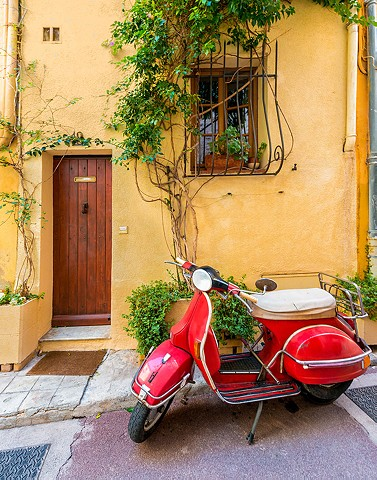 Vintage Red Vespa with a beautiful yellow background