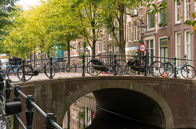 Bicycles locked to the canal bridge Amsterdam