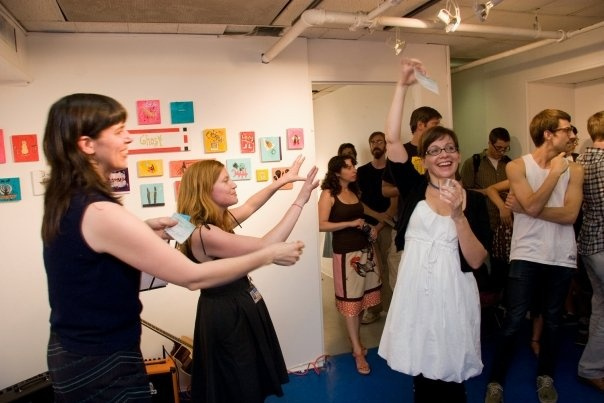 Handing out a check to artist/employee Janine Menlove at a Payday Party