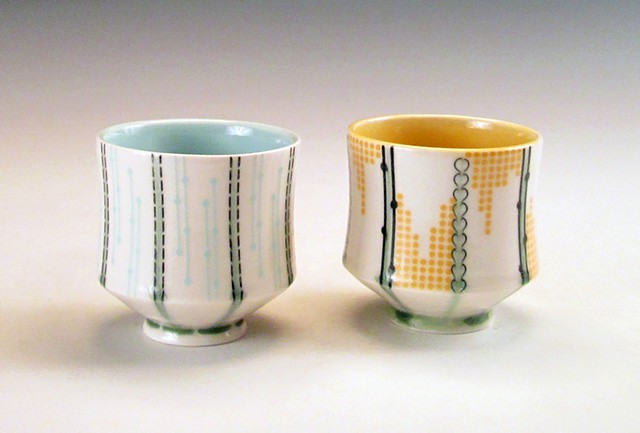 2 porcelain slip cast cups with underglaze and overglaze decals