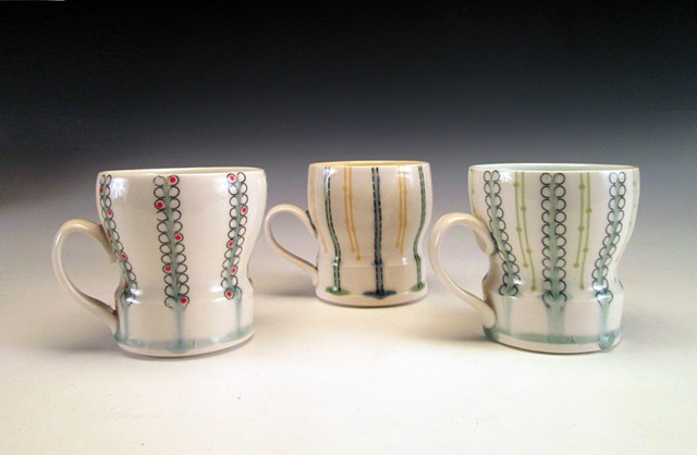 3 thrown porcelain cups with handles with underglaze and overglaze decals