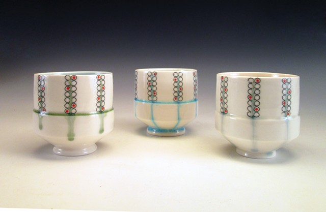 3 slip cast porcelain cups with underglaze and overglaze decals