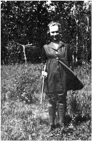 Nina Weiste with gun.