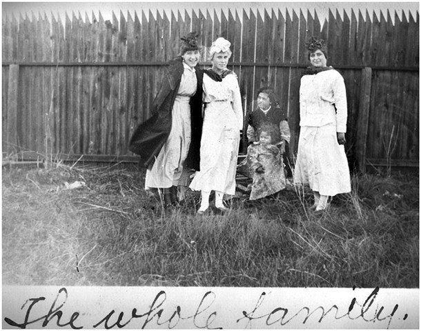 """The Whole Family"" (Nina second from left). I wondered about the social status of the seated mother and child. A few years later the Ellendale Museum received an album of photographs taken by one of Nina's friends in this picture. The inscription on the b"