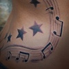 Kelly Clarkson music notes and stars on rib
