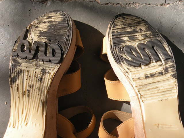 "Carved shoes with the words ""me"" and ""and"" on the soles. By Courtney Kessel"