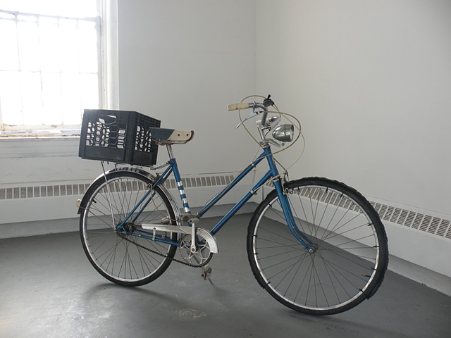 Bicycle sculpture created with the intention of bike tracks in the form of a sentence.