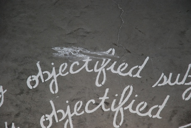 "The words ""subject"" and ""object"" mutate into various versions of themselves as they spiral in or out from the center."