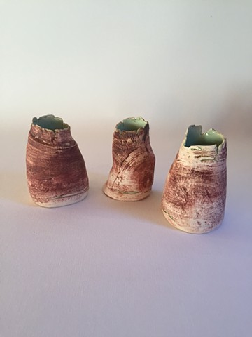 3 small red and green pots- £100