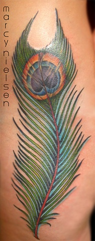 peacock feather tattoo on hip