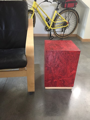 Modern OSB Pedestal table, red OSB finish.
