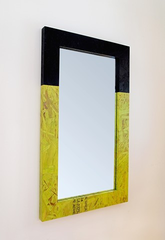 Modern OSB mirror with two tone frame in lime green and black. Colored and stained OSB frame.