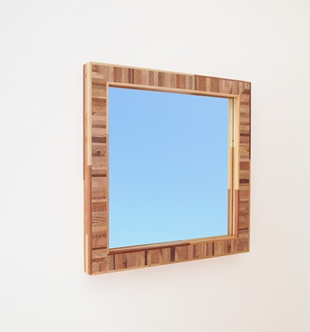Handmade modern mirror with a multi-colored softwood frame; custom mirrors by Andrew Traub
