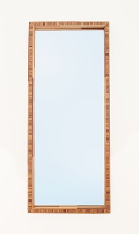 Modern end grain wood mirror made from scrap and salvaged wood with multicolored calico frame by Andrew Traub. Custom mirrors.