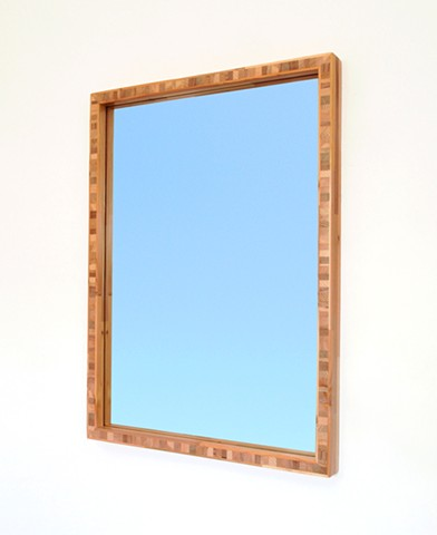 Modern wood mirror with a block wood core made for scarp and salvaged wood