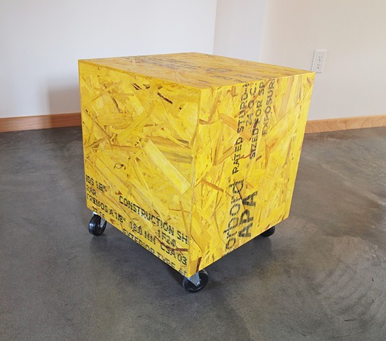 Modern osb furniture, cube table on casters made from yellow osb. Muse Cube table, handmade Andrew Traub Studio, Andy Traub