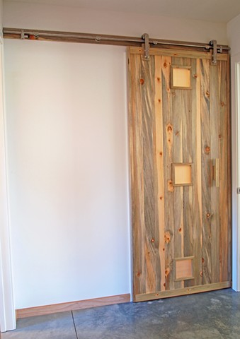 Modern sliding barn door made with blue pine designed and handmade by Andrew Traub.