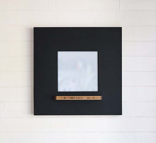 Modern chalkboard and mirror with a blackboard finish creating a usable chalkboard frame. Designed and handmade by Andrew Traub.
