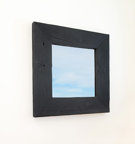 Modern rustic black mirror with charred wood frame. Custom made shou sugi ban mirrors.