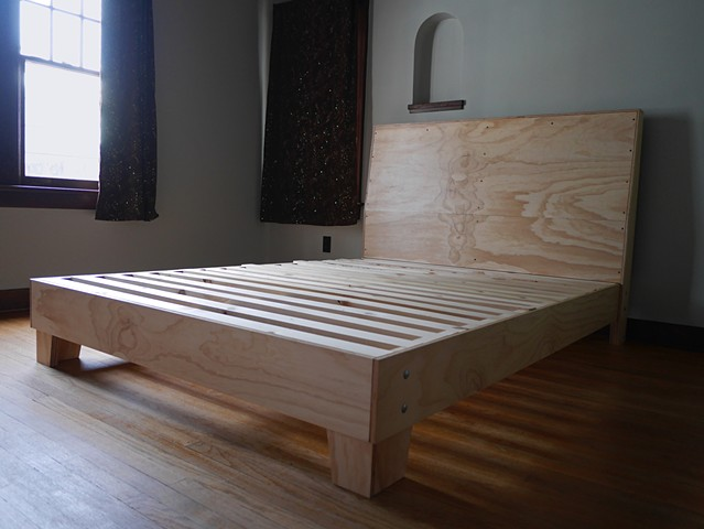 Modern plywood bed frame designed and built by Andrew Traub