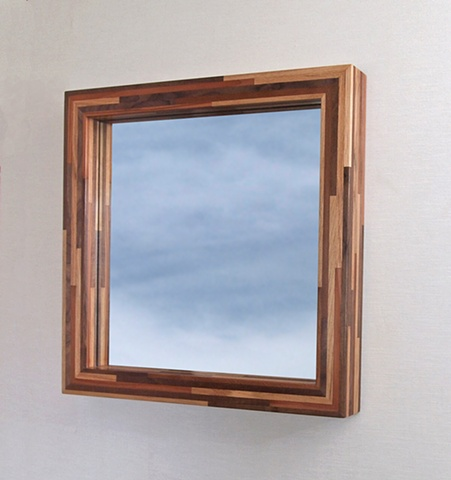 Modern handmade wood mirror frame made with scrap and salvaged woods