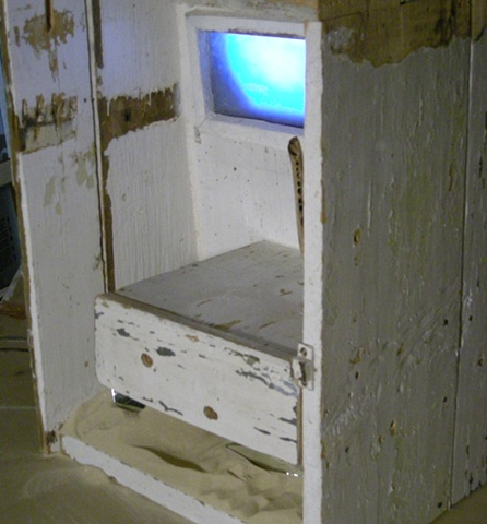 Re-purposed Wood Cabinet, Sand, Mirror, Bone, DVD, LCD Screen sculpture