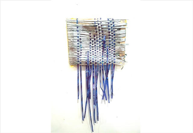 woven silver paint tapestry on wooden stretcher bars
