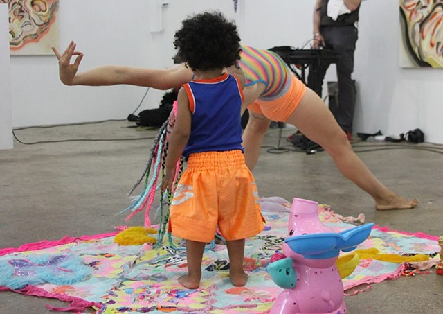 floor-mounted fabric assemblage during Pussy Whispering performance