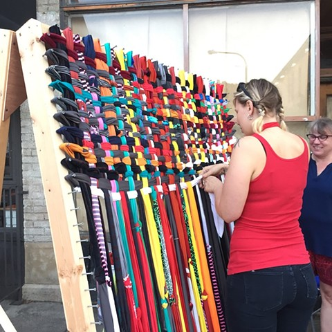 Collaborative weaving created during August First Friday's Art Chase, Allentown neighborhood, Buffalo