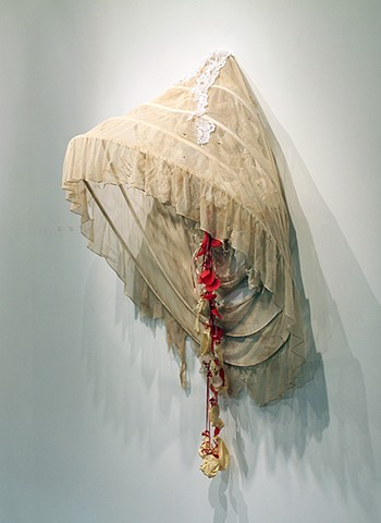 hoop skirt with mixed media sculpture