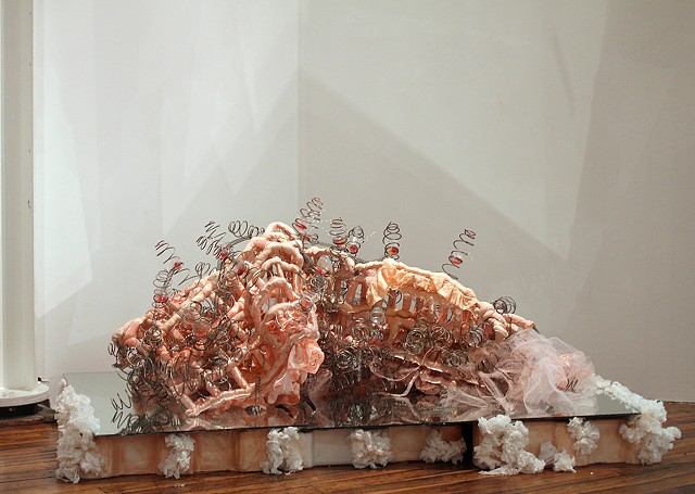 mixed media sculpture using bridesmaid dress and mattress springs