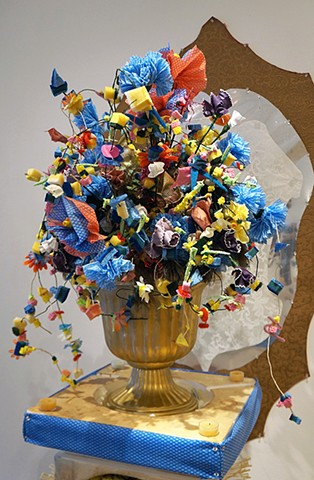 arrangement with flowers made from sponges, disposable rags, feather dusters and brushes