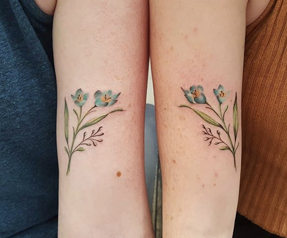 Soft floral sister tattoos by Sandra Burbul