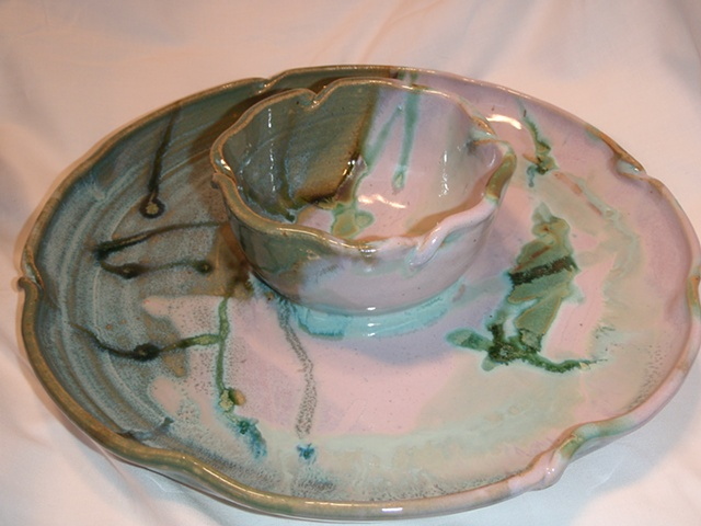 Stoneware pottery, tie-dye lavender and green chip n dip serving dish with attached bowl.