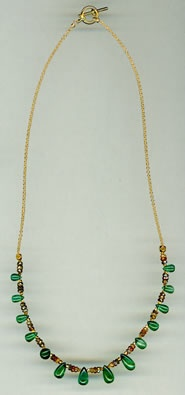 Emeralds, Spessartine Garnets and Zircon with 18kt. Gold