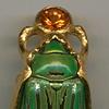 Scarab Spessartine Garnet  24kt. Gold Underside is amber