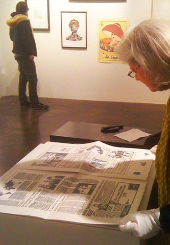 Mari reading The Chronicle Times at Kala Artists' Annual, 2013