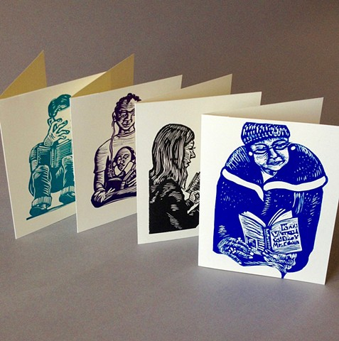 set of linoleum cut note cards of people reading