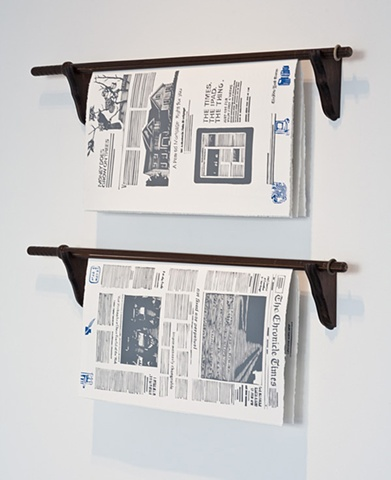 two copies on library newspapers sticks