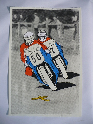 Motorcycles racing about to slip on a banana peel