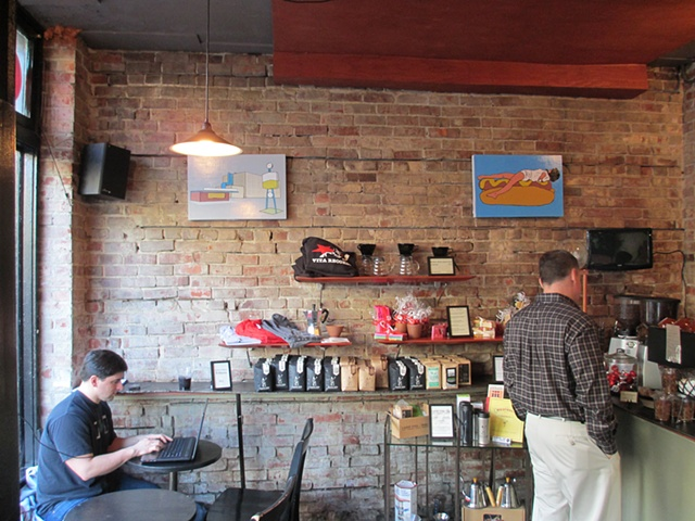 My artwork hanging at Cafe Vita on Queen Anne
