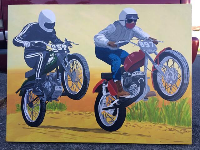 Motorcycles racing through the desert